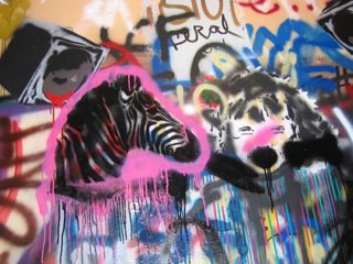 """Some of the stencil work in UCSD's """"Graffiti Hall"""" which I got a tour of after the presentation."""
