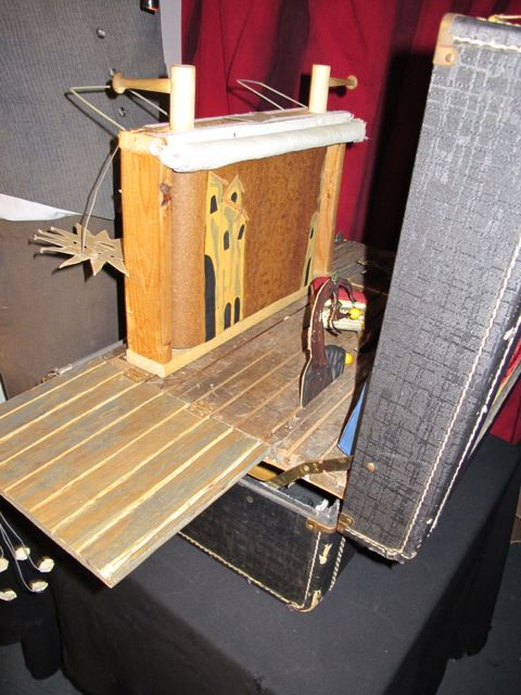 As a backdrop for the Bread & Puppet ding dong show, the small cranky box is used to change scenes and create depth and movement. It all fits in the case/stage!